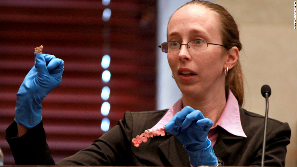 <strong>June 2011: </strong>Jennifer Welch, a crime scene investigator with the Orange County Sheriff's Office, shows letters from Caylee's T-shirt that were entered into evidence.