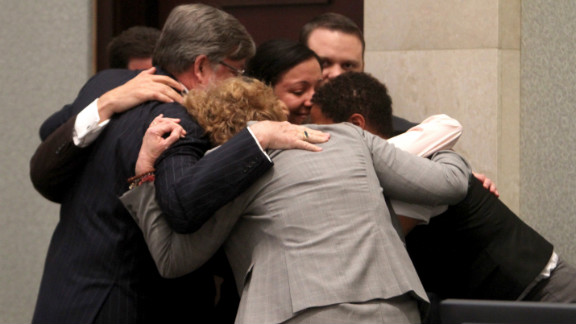 July 5, 2011: Casey Anthony's defense team surrounded her in a group hug after the then-25-year-old was acquitted.