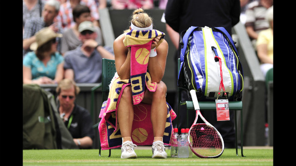 Kerber buries her head in her towel during a break between games in her Ladies