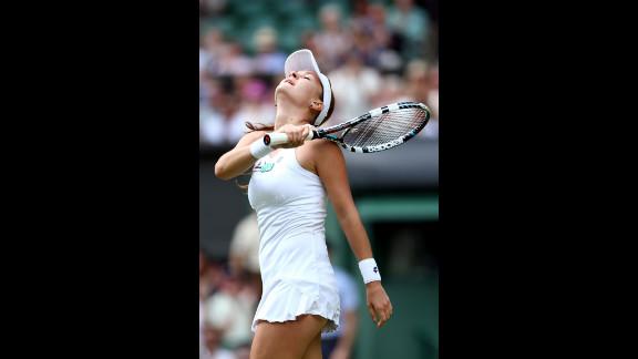 Radwanska celebrates after winning her Ladies