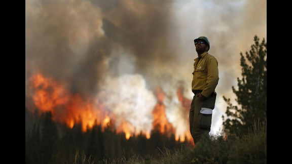 Firefighter Alex Abols monitors fire on the north flank of the Fontenelle Fire outside Big Piney. Record fire danger and long stretches of the red flag warning days have made it challenging to control.