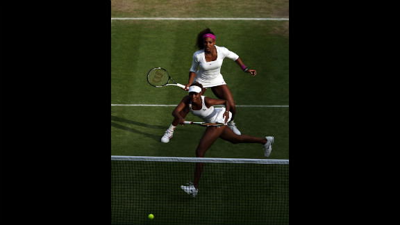 Serena Williams, top,  and Venus Williams of the United States team up in their women