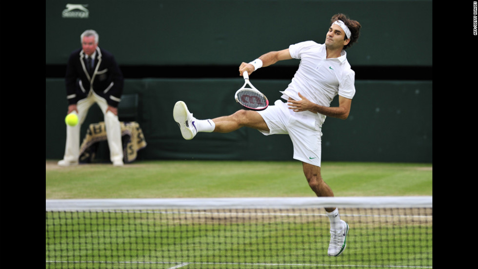 Roger Federer plays a shot during his men's singles semifinal match against Novak Djokovic.