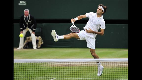 Roger Federer plays a shot during his men