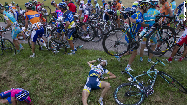 Pain game: Dutchman Wouter Poels falls victim to the mass pile-up on the sixth stage of the Tour de France.