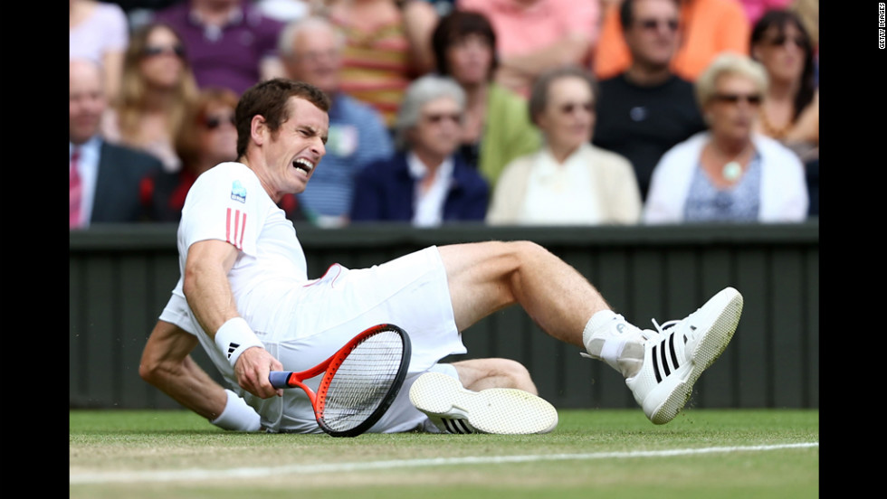 "Murray grimaces as he slips to the ground. See the action as it unfolds here, and visit <a href=""CNN.com/tennis"">CNN.com/tennis</a> for complete coverage."