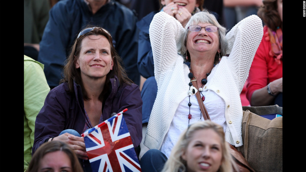 "A fan on ""Murray Mount"" cannot bear to watch during Andy Murray's semifinal match against Jo-Wilfried Tsonga of France on Friday, June 6 at Wimbledon."