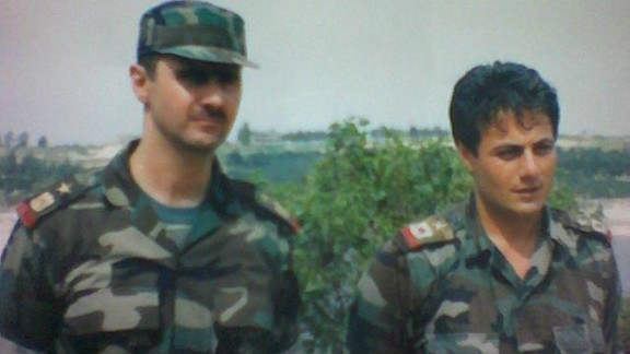 Brig. Gen. Manaf Tlas, right in an undated photo with Bashar al-Assad, has been a key member of the Syrian president's regime.