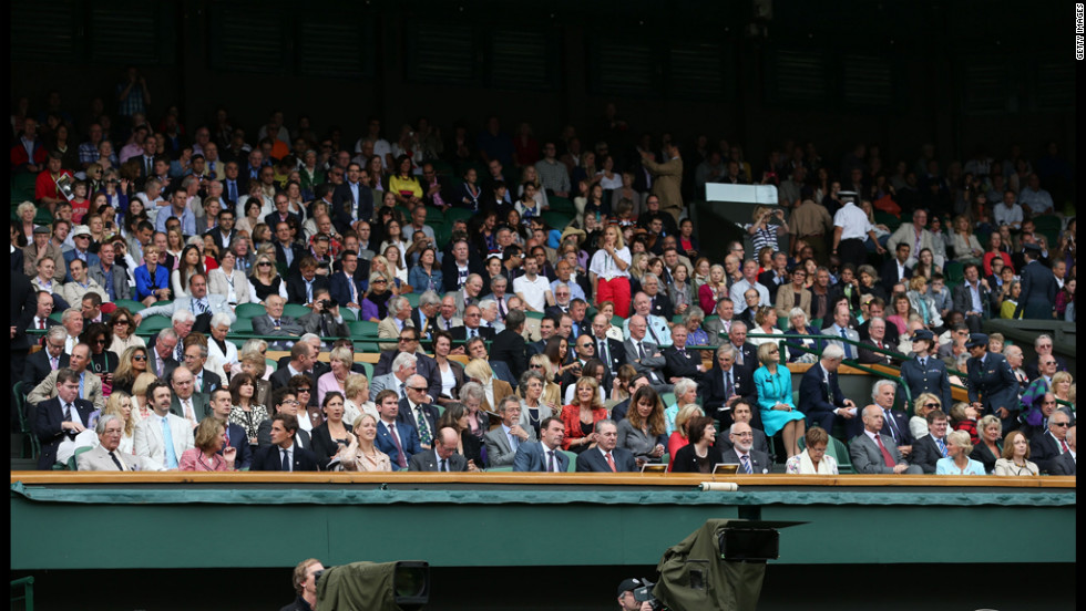 Spectators in the royal box on Centre Court wait for the final match to begin on Saturday.