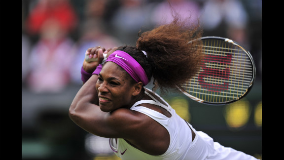 U.S. player Serena Williams swings the racket during her match against Poland