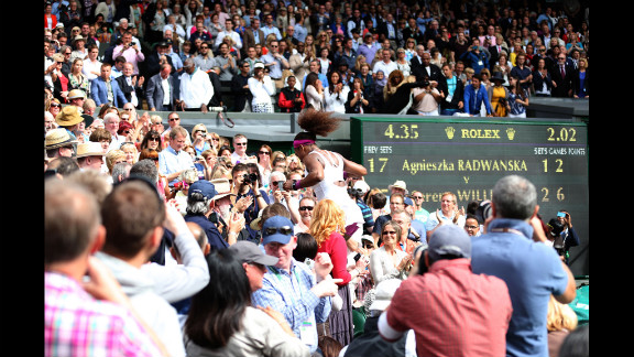 U.S. player Serena Williams rushes through the stands to celebrate with her family after winning the women