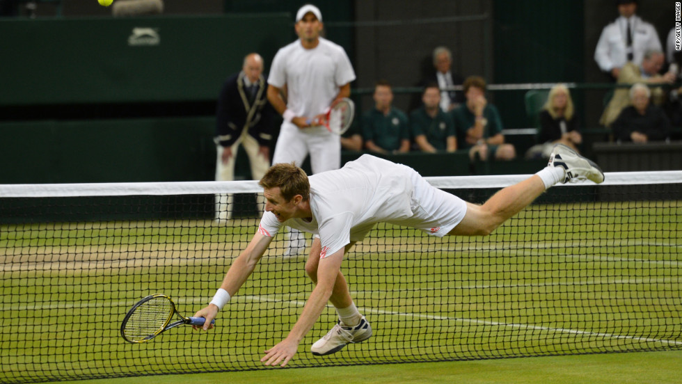 Jonathan Marray of Great Britain reaches for a shot during his men's doubles final victory.