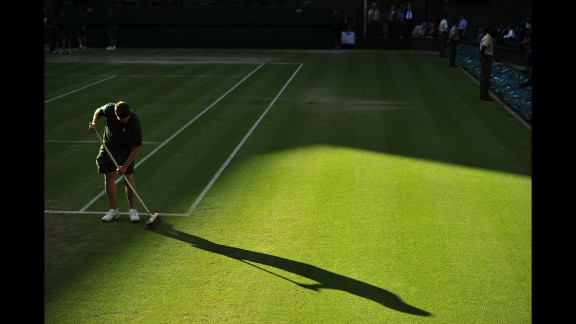 A groundskeeper prepares the grass on Centre Court on Friday.