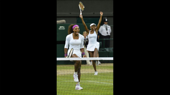 Sisters Serena and Venus Williams of the United States celebrate following their win against Czech Republic