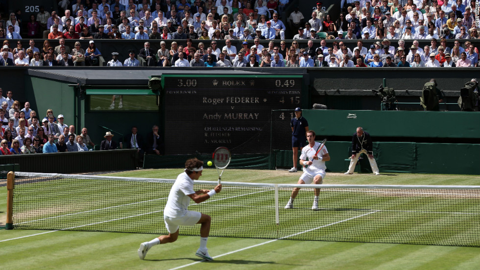 Federer, left, returns a shot from Murray during the men's singles Wimbledon championship in London on Sunday.