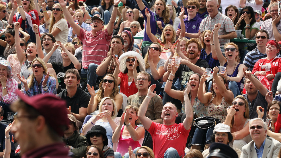 Fans cheer during the first set of the championship match Sunday.
