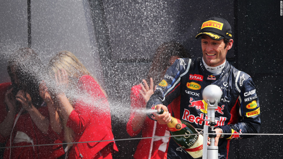 Red Bull's Australian driver Mark Webber celebrates after winning the British Grand Prix at Silverstone -- his second victory of the 2012 season. The Australian held off Ferrari's Fernando Alonso in a close battle to win the race.