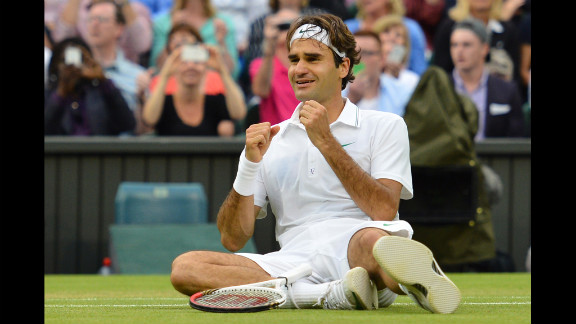 Roger Federer of Switzerland celebrates after defeating Andy Murray of Great Britain to win his 7th Wimbledon championship in London on Sunday, July 8. Visit CNN.com/tennis for complete coverage.