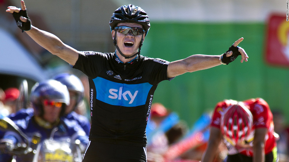 Great Britain's Christopher Froome celebrates as he crosses the Stage 7 finish line on Saturday to take the win.