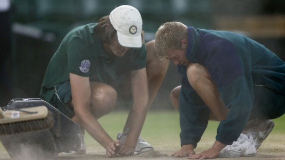 Great detail is taken as grounds crews prepare Centre Court for Sunday's historic match between Roger Federer and Andy Murray in the Wimbledon Championships at the All England Lawn Tennis and Croquet Club in London. Federer is seeking to tie the record for most men's singles titles at Wimbledon, and Murray is shooting to become the first British male to win his nation's major singles championship in 76 years. See the action as it unfolds here, and visit CNN.com/tennis for complete coverage.