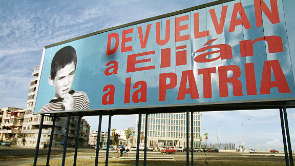 """A billboard from 1999 in Havana reads """"Return Elian to this nation."""" Cuban citizen Elian Gonzalez was at the center of an international custody battle between the U.S. and Cuba after being found off the Florida coast by fishermen in 1999."""