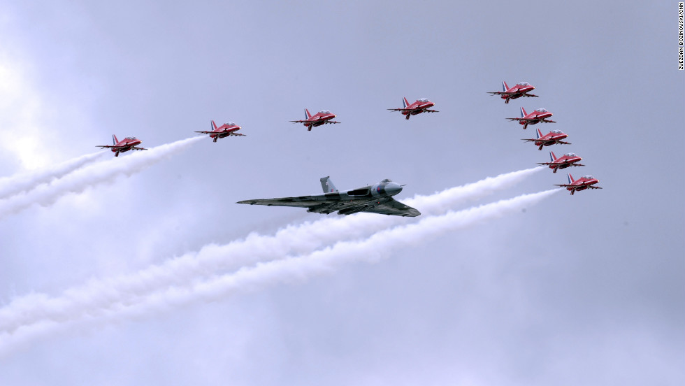 The RAF Red Arrows take to the skies with the last remaining flying Vulcan for a flypast to open the week's aviation festivities.