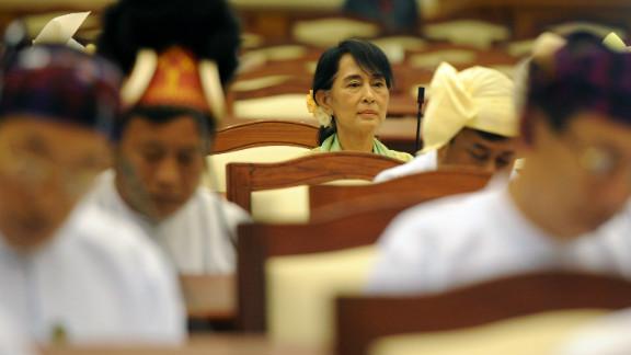 Aung San Suu Kyi sits in Myanmar