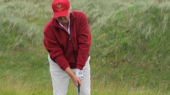 Trump, who has delayed plans to build an extended $1 billion resort on the east coast of Scotland, hits the course's first ever shot.