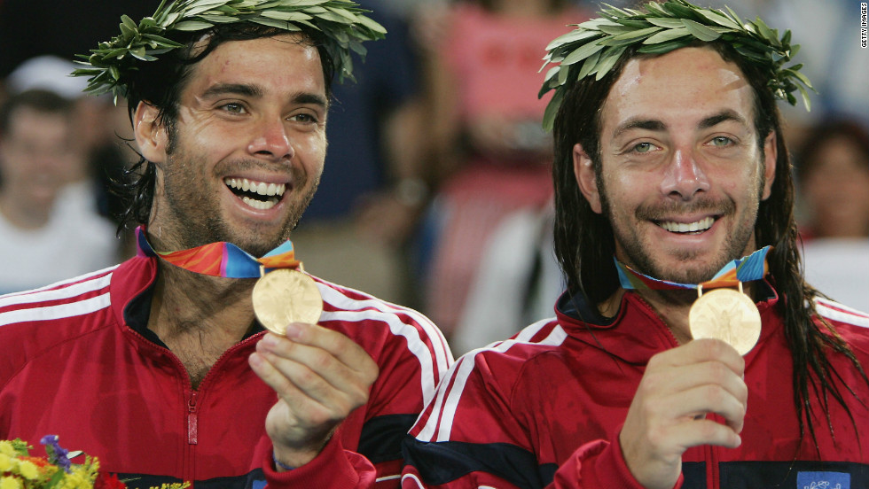 Gonzalez and partner Nicolas Massu proudly show the gold medals they won in the men's doubles at the 2004 Olympics in Athens.