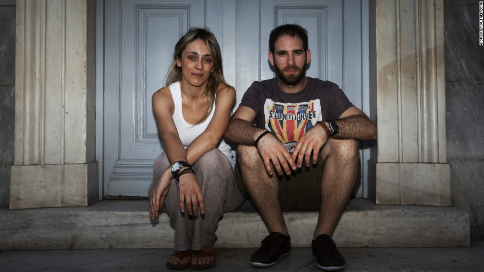 Maria Papanagiotaki and Aristotle Skalizos, part of Greece's young professional class. They have been dating for more than two years but have different views on whether to stay in Greece or leave for opportunities elsewhere.