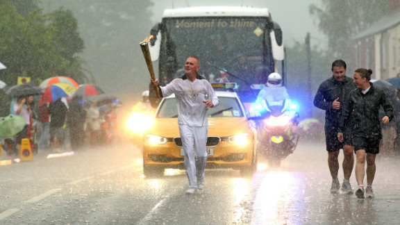 The Olympic torch has been on a tour of the UK since May 19 and while there have been many days filled with sunshine, others, like this one near Mansfield, have proved a threat to the flame itself.