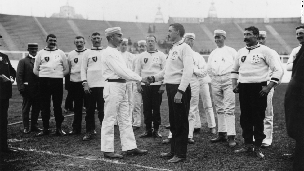 Captains of the Swedish and English tug-of-war teams shake hands at the tournament held in Crystal Palace.