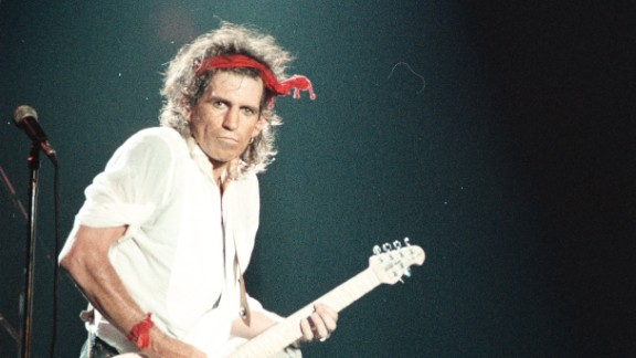 """Guitarist Keith Richards performs at the Aragone Ballroom in Chicago, Illinois, in 1987. The songwriter collaborated with Mick Jagger on their first international number 1 hit """"(I can"""