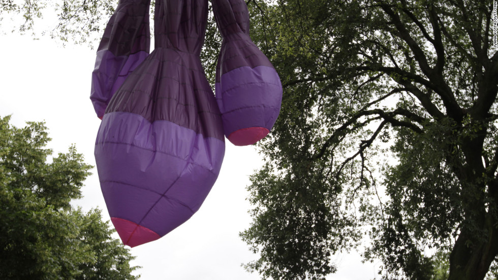 "Michael Shaw installed large inflatable balloons on trees in the Chelsea Physic Garden. ""There is no 'Greenpeace message' in the piece,"" he says. ""But it relates to environment, it is responsive to it. Where the sculpture is depends on the wind."""