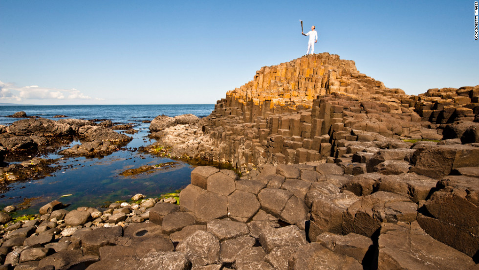 Triathlete Peter Jack holds the Olympic flame while on the Giant's Causeway in Northern Ireland on June 4.