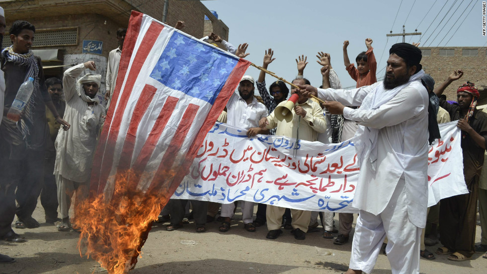 A Man Burns The US Flag In Protest Of Drone Strike Multan Pakistan