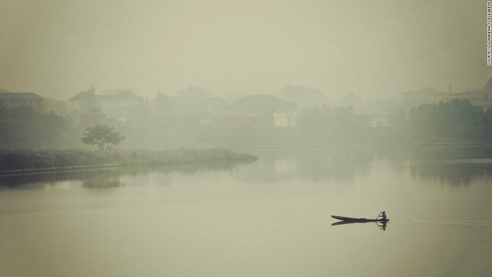 A lone boatman makes his way across Jabi Lake, Abuja, in the early hours of the morning.