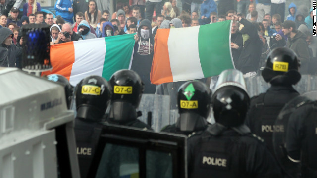 Protesters clash with police after a march in North Belfast, in Northern Ireland, on July 12, 2012.