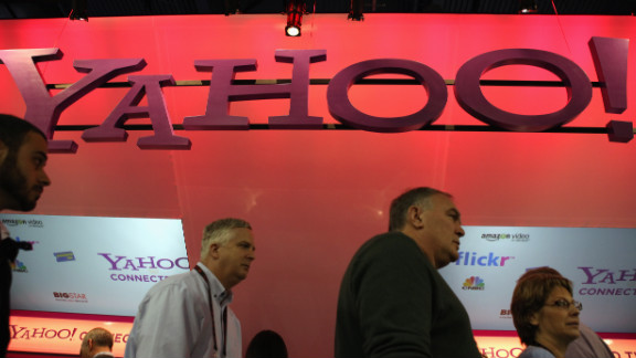 Visitors walk past the Yahoo booth at the Consumer Electronics Show in Las Vegas.