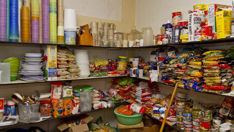 With a well-stocked pantry, cooks prepare warm meals for dozens of Central American immigrants daily.