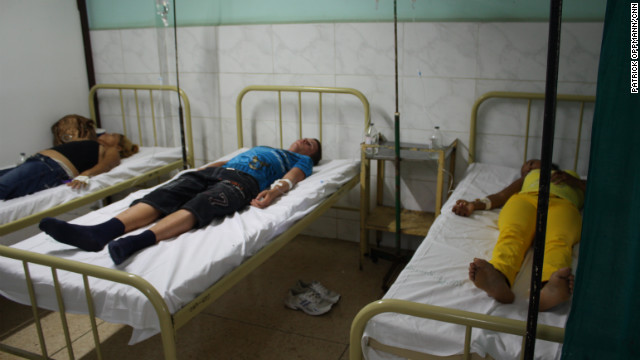 Patients are treated Wednesday at a hospital in Manzanillo, Cuba, where doctors are battling a cholera outbreak.
