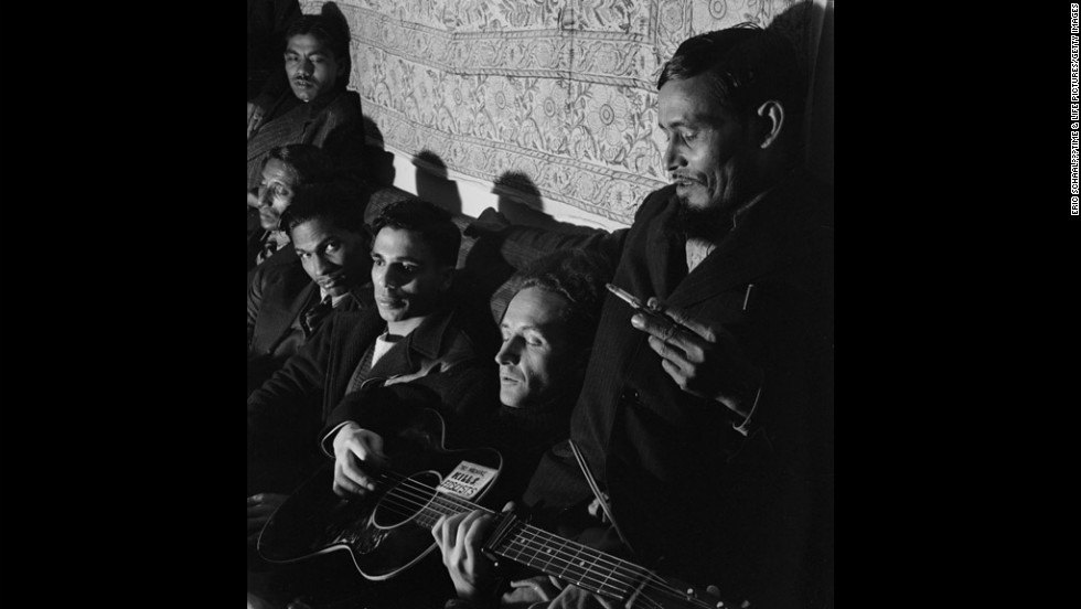 Woody Guthrie sings at the American Club for Indian Seaman in New York, 1943.