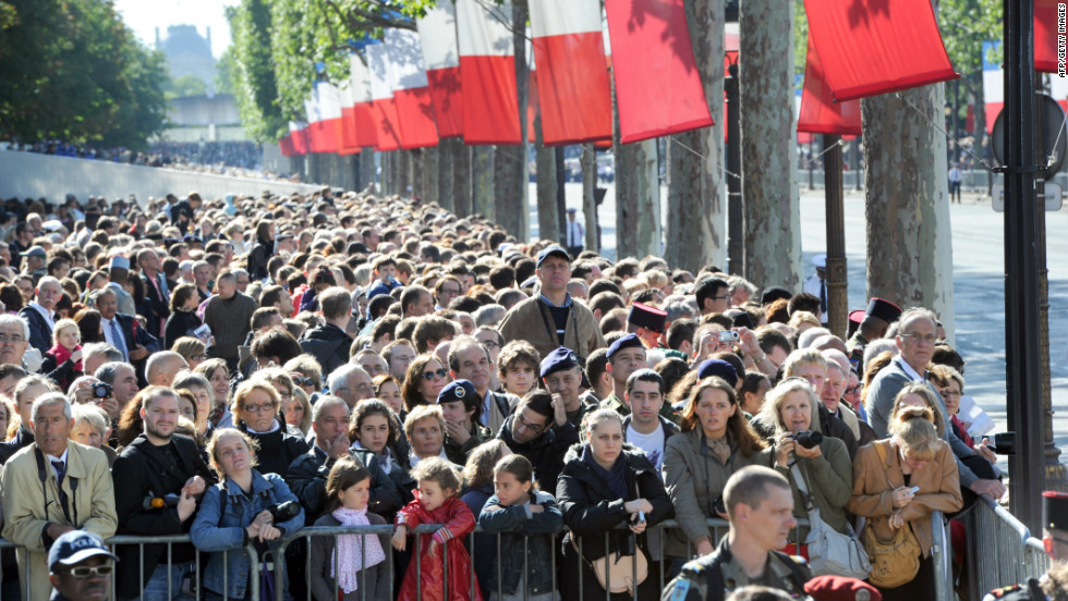 Crowds line the Champs Elysees to watch the Bastille Day parade.