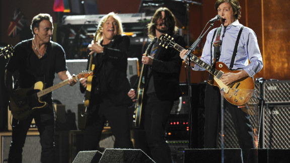 """He was joined for the finale by Beatles legend Paul McCartney. The two, seen here with Joe Walsh and Dave Grohl at the Grammys in February, played """"I Saw Her Standing There"""" and """"Twist and Shout"""" before the power was pulled by concert organizers."""