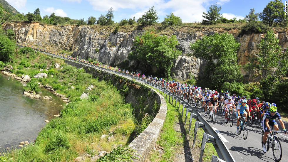 Riders make their way around a bend during Sunday's stage, which is the first in the Pyrenees mountains.