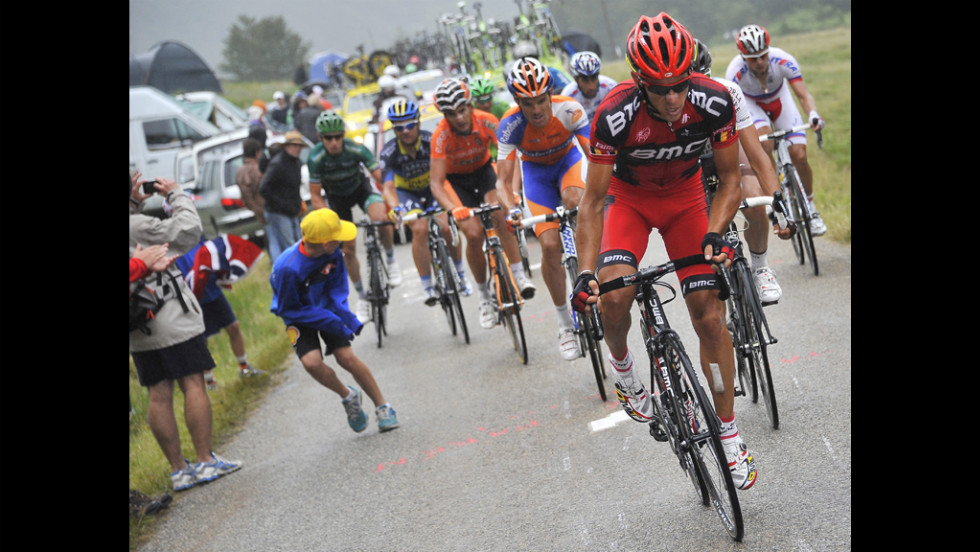Philippe Gilbert of Belgium and Team BMC leads a breakaway group as rain starts to fall Sunday.