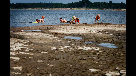 Swimmers relax in the shallow waters of the Mississippi River at Meeman-Shelby Forest State Park in Tennessee on July 6. Drought conditions have lowered the river