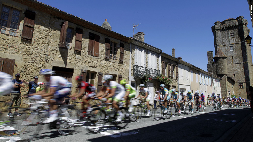 Spectators cheer on riders as they pass through a small village along Monday's route.