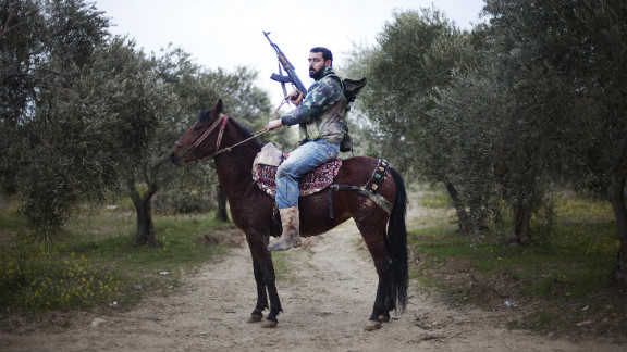 A Free Syrian Army rebel mounts his horse in the Al-Shatouria village near the Turkish border in northwestern Syria on March 16, 2012, a year after the uprising began.