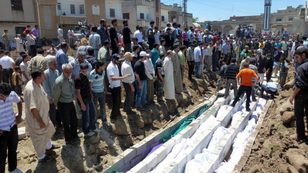 People gather at a mass burial on May 26, 2012 for victims reportedly killed during an artillery barrage from Syrian forces in Houla. The attack left at least 108 people dead, including nearly 50 children, according to the United Nations.